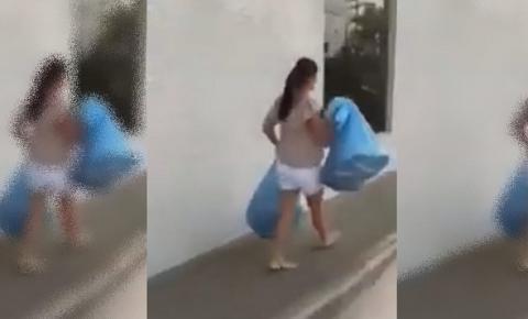 Vídeo: traída, mulher deixa roupas do marido em agência bancária