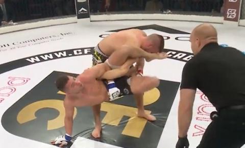 Imagem forte: braço de lutador de MMA gira e quebra após golpe