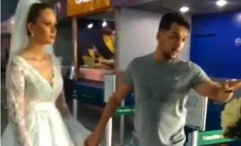Vestida de noiva, mulher 'foge com amante' em aeroporto: ASSISTA